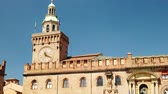 emilia : SLOW MOTION: clock tower of Palazzo dAccursio or Comunale overlooking Piazza Maggiore, today the seat of the municipality of Bologna in Italy. Stock Footage