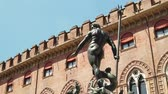 emilia : SLOW MOTION: Nettuno 1567 bronze statue fountain in front of Accursio palace, built in 1290, in Piazza Maggiore square, the seat of the municipal government of Bologna city in Emilia region of Italy. Stock Footage