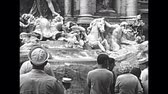 soldati romani : ROME, ITALY - CIRCA 1960: Tourists and marine sailors visiting the Trevi Fountain in Rome city. BW historical archival of Rome capital of Italy in the 1960s.