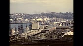 archief : DURBAN, South Africa - circa 1981: Top panorama of the port of Durban with cargo ships and skyscrapers. Historical archival footage in Durban harbor of the 1980s in South Africa. Stockvideo