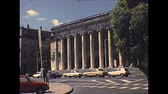 hetvenes évek : NIMES, FRANCE - CIRCA 1970: ionic columns of historical building architecture of Nimes town with vintage cars in on the road. Historical archival of southern France in the 1970s.