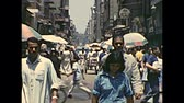 çarşı : CAIRO, EGYPT, AFRICA - circa 1973: Khan Al-Khalili Bazaar with local Egyptian people in a traditional Arab dress. Historical archival of Cairo capital city of Egypt in the 1970s. Stok Video