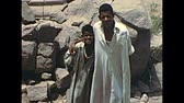 Mit-Rahineh, EGYPT, AFRICA - circa 1973: Egyptian Bedouin boys in Giza archeological site in traditional dress. Memphis ruins by Mit-Rahina town. Historical archival of Cairo of Egypt in the 1970s