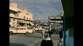 filistin : GAZA, PALESTINE, ISRAEL - CIRCA 1979: a square of the Gaza with local people in Palestinian dress and vintage cars, under the occupation of Israel until 1993. Archival of Palestine in 1970s Stok Video