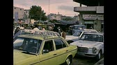 filistin : GAZA, PALESTINE, ISRAEL - CIRCA 1979: cars of Gaza and Palestine people in vintage Palestinian dress, during the occupation of Israel until 1993. Archival of Palestine in 1970s Stok Video