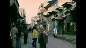 filistin : GAZA, PALESTINE, ISRAEL - CIRCA 1979: Arab shops of the old Gaza city with Palestinian people in typical Keffiyeh, Arab headdress. During the Israeli occupation. Archival Israel and Palestine in 1970s Stok Video