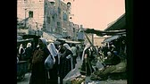 místní : BETHLEHEM, WEST BANK - CIRCA 1979: Streets life of the old town with local people in typical Palestinian dress, working and shopping in the markets and shops. Archival of Israel and Palestine in 1970s