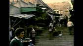 palestine : BETHLEHEM, WEST BANK, ISRAEL- CIRCA 1979: stairway of local street food markets with people. Archival of Israel and Palestine in the 1970s. Stock Footage
