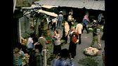 filistin : BETHLEHEM, WEST BANK, ISRAEL- CIRCA 1979: Panorama of the market of the local life with people in Palestinian dress, working and shopping on the road. Archival of Israel in the 1970s.