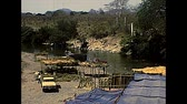 CHIAPAS, MEXICO - circa 1970: roads of Chiapas with Mexican people working and washing clothes in the river. Archival of Mexico in South America in 1970s.