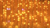 ziyafet : golden lights background with Christmas lights in yellow and orange colors. Copy space Stok Video