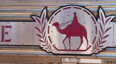 efsanevi : Alice Springs, Northern Territory, Australia - Aug 29, 2019: The legendary Ghan train stops at Alice Springs station on the Adelaide-Darwin route with the camel logo. SLOW MOTION.