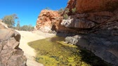 отраженный : Viewpoint between Pound Walk and Ghost Gum Walk where rocky cliffs of Ormiston Gorge reflected in a pool on dry river in West MacDonnell Range.Northern Territory, Central Australia, Outback Red Centre