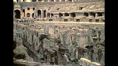 kolosszeum : ROME, ITALY - circa 1986: Rome coliseum interior with tourists visiting, Flavian Amphitheatre, largest amphitheater in the world of Rome city. Historical archival of Rome capital of Italy in 1980s. Stock mozgókép