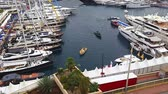 миллионер : Monte Carlo, Monaco - October 01, 2016: Luxurious Yachts Megayacht And Are Lined Up In The Monte Carlo Harbour During The 2016 Monaco Yacht Show (MYS) in Monaco, French Riviera Стоковые видеозаписи