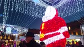 túmulo : Toulouse, France - December 14, 2016: Beautiful Santa Claus on Christmas Market in the City Center of Toulouse (Capitol Place), Midi Pyrenees, France