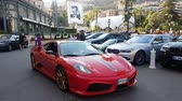 züppe : Monte Carlo, Monaco - August 17, 2017: Man Driving A Red Ferrari 430 Scuderia In Front Of The Casino Of Monte Carlo In Monaco, French Riviera Stok Video