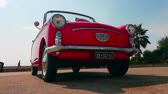 хром : Menton, France - September 9, 2017: Red Autobianchi Bianchina Convertible Parked on the Esplanade Francis Palmero in the City of Menton on the Riviera - 4K Video