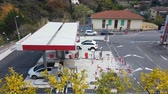 gasoline tank : Menton, France - December 16, 2017: Aerial View of an Intermarket Gas Station (Petrol, Diesel) in Menton on the French Riviera. Intermarchà © is the Brand of a General Commercial French Supermarket - 4K Video