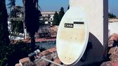 satelite : Granada, Spain - April 3, 2017: Canal Satelite Digital. White Satellite Dish On The Roof House. Satellite Dish Hanging on the Chimney House