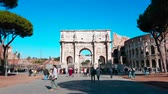 triumphal arch : Rome, Italy - February 10, 2018: Hyperlapse - Timelapse of Arch of Constantine, Triumphal Arch in Rome and Colosseum in The Background - 4K Video
