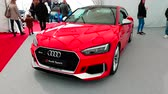 хром : Monte-Carlo, Monaco - February 18, 2018: Red Audi RS 5 Coupe on Display During the Siam 2018 (Monaco Motor Show). Audi is a German Automobile Manufacturer That Designs, Engineers, Produces Luxury Vehicles - 4K Video Стоковые видеозаписи