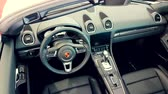 roadster : Monte-Carlo, Monaco - February 18, 2018: Interior of the New 718 Boxster on display during the Siam 2018 (Monaco Motor Show). The Porsche Boxster is a Sports Car built by Porsche - 4K Video Stock Footage