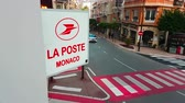mounted : Monte-Carlo, Monaco - February 18, 2018: Signboard Post of France Post on The Wall in Monte-Carlo, Monaco. The Post is a French Postal Service Company - 4K Video
