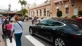 mounted : Monte-Carlo, Monaco - October 28, 2017: Man Driving An Expensive Black Tesla Model S in Front of the Monte-Carlo Casino in Monaco in The French Riviera - 4K Video