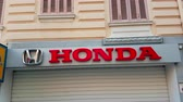 króm : Monte-Carlo, Monaco - February 18, 2018: Honda Company Logo on the Wall of a Shop. Honda is a Japanese Public Multinational Conglomerate Corporation Known as a Manufacturer of Automobiles, Motorcycles, Robots, Aircraft, And Power Equipment - 4K Video