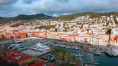 session : Nice, France - March 9, 2018: Timelapse Aerial View Over The Port of Nice (Port Lympia) Colorful Historical Houses, Boats And Luxury Yachts - 4K Video
