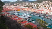 шансы : Nice, France - March 9, 2018: Aerial View Over The Port of Nice (Port Lympia) Colorful Historical Houses, Boats And Luxury Yachts - 4K Video