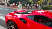лоб : Monte-Carlo, Monaco - April 21, 2018: Man Driving A Red 488 GTB Ferrari In The Streets Of Monte-Carlo, Monaco in The French Riviera - 4K Video