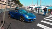supercar : Monte-Carlo, Monaco - April 21, 2018: Man Driving a Blue TopCar Stinger GTR Porsche 911 Turbo Cabriolet 2018 on The Road of the Monaco F1 Grand Prix Circuit (Port Hercules), Start-Up And Fast Accelerations - 4K Video