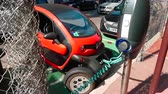 mounted : Monte-Carlo, Monaco - April 21, 2018: French Mini Renault Twizy Electric Charging Car On Street in Monaco - 4K Video