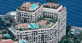 fontvieille : Fontvieille, Monaco - May 18, 2018: Aerial View of Luxurious Apartments With Rooftop Pool Located in the Fontvieille District, Principality of Monaco, French Riviera, Europe - DCi 4K Resolution