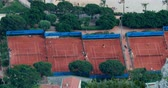 racketeering : Cap-dAil, France - May 18, 2018: Aerial View Of Four Luxurious Tennis Courts And Players Playing Tennis On Court At Monaco Tennis Club, French Riviera, Europe - DCi 4K Resolution Stock Footage