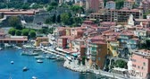 шансы : Villefranche-sur-Mer, France - May 20, 2018: Beautiful Aerial View of Villefranche-Sur-Mer with The Harbor, Famous Village on French Riviera, Alpes-Maritimes, France, Europe - 4K Video