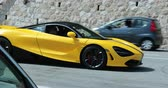 supercar : Beaulieu-sur-Mer, France - June 9, 2018: Beautiful Yellow McLaren 720S Supercar (Side View) Parked In The Street Of Beaulieu-sur-Mer On The French Riviera, Alpes-Maritimes, France, Europe - 4K Video Stock Footage