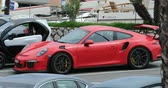 rs : San Remo, Italy - June 10, 2018: Beautiful Red Porsche 911 GT3 RS (Side View) Parked In The Street Of The City Center Of San Remo, Liguria, Italy - 4K Video