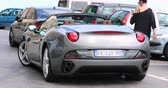 alaşım : Beaulieu-sur-Mer, France - June 9, 2018: Beautiful Gray California Ferrari 4.3 V8 460 Supercar (Rear View) Parked In The Street Of Beaulieu-sur-Mer On The French Riviera, Alpes-Maritimes, France, Europe - 4K Video