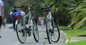 domingo : San Remo, Italy - June 10, 2018: Timelapse Of Two Bicycles On A Bike Path In Sanremo, Blurred People In The Background. Liguria Italy, Europe- 4K Video