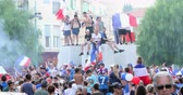 street parade : Menton, France - July 15, 2018: 2018 FIFA World Cup Russia: France Celebrate In Menton Supporters After Winning The World Cup With 4-2 Victory Over Croatia - DCi 4K Resolution Stock Footage