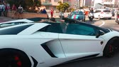 supercar : Monte-Carlo, Monaco - April 21, 2018: Luxury Black And White Lamborghini Aventador LP 700-4 Roadster (2016) Driving Around the Fairmont Famous Hairpin Turn in Monte Carlo, Monaco in The French Riviera - 4K Video Stock Footage