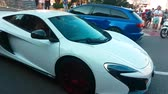 supercar : Monte-Carlo, Monaco - April 21, 2018: Luxury White Mclaren 650 S Driving Around the Fairmont Famous Hairpin Turn in Monte Carlo, Monaco in French Riviera - 4K Video Stock Footage