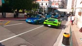 supercar : Monte-Carlo, Monaco - April 21, 2018: Three Luxury Lamborghini Huracan LP 610-4 Cup (Green, Black And White Color) In The Streets Of Monte-Carlo, Monaco in The French Riviera - 4K Video