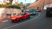 supercar : Monte-Carlo, Monaco - April 21, 2018: Orange Jaguar F-General Type Lee (MM Luxury Custom Covering) In The Streets Of Monte Carlo, Monaco in French Riviera - 4K Video