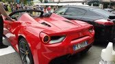 króm : Monte-Carlo, Monaco - September 23, 2018: Rear View Of A Beautiful Red Ferrari 488 Spider In Front Of The Monte-Carlo Casino In Monaco In The French Riviera, Europe - 4K Video
