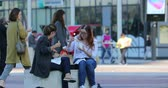 la defense : Paris, France - October 16, 2018: Women Sitting And Eating Fast Food In The Street, District Of The Defense, Paris, France, Europe - DCi 4K Resolution