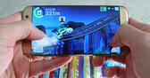 mert : Paris, France - November 17, 2018: Man Playing MMX Hill Dash 2 Video Game On His Modern Samsung Galaxy S7 Edge Smartphone At Home, Close Up View - DCi 4K Resolution